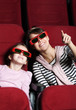 A girl with mother in 3D movie theater