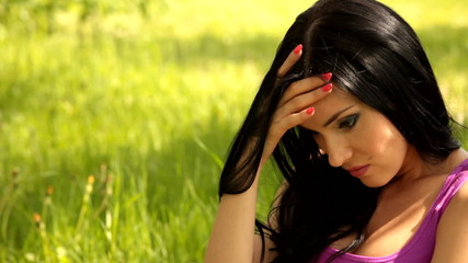 Beautiful young woman looking depressed