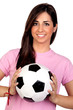 Atractive girl with a soccer ball
