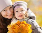 Happy family in autumn park