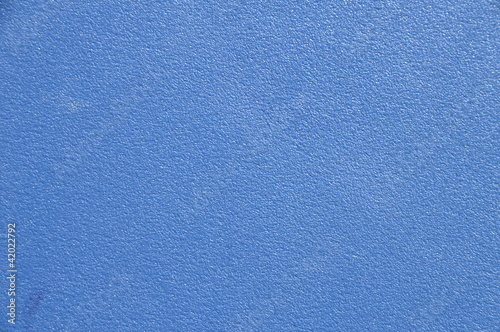 Blue painted wall with roughcast for background or texture