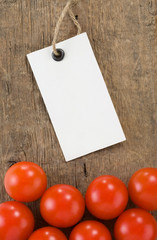 price tag and tomato vegetable at wood background