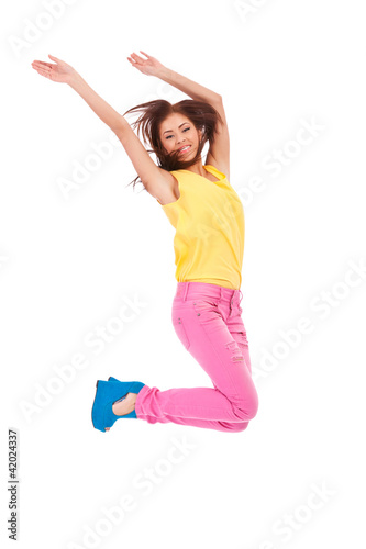 casual young excited woman  jumping in air
