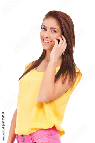 smiling young casual woman speaking on phone