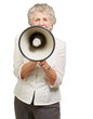 portrait of senior woman screaming with megaphone over white bac