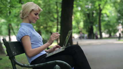 Businesswoman finish work on laptop and relaxing in park