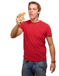 portrait of young man eating pizza portion over white backgorund