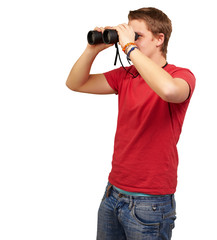 portrait of young man looking through a binoculars over white ba