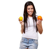 young pretty girl holding orange and lemon over white background