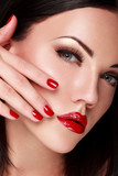 Close-up face of beautiful  woman with red lips.