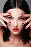 Close-up face of beautiful woman with red lips
