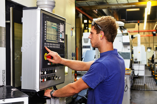 canvas print picture skilled worker controlling a digitally programmed machine tool