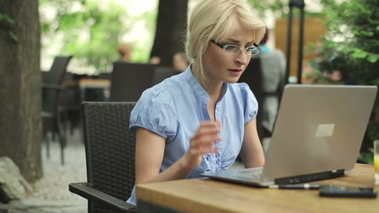 Successful businesswoman in front of the laptop in cafe