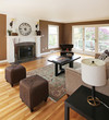 Brown livinng room with white fireplace and luxury furniture.