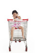 Cute Asian Girl Inside Shopping Trolley