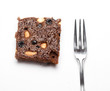 Piece of brownie with fork on white isolated background