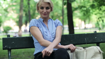 Portrait of young businesswoman in the park, steadicam shot