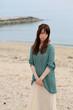A young woman at beach / Long hair