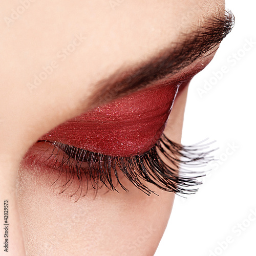 Woman eye with long eyelashes. High quality image