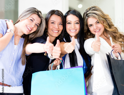 Shopping women with thumbs up