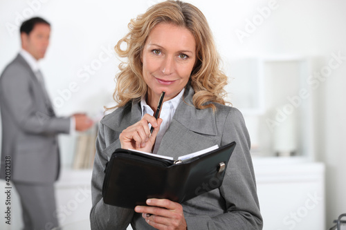 Blond woman with book in hand