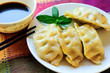 Four Chinese Gyoza, Soy Sauce, Chopsticks