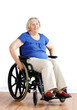 Senior woman in wheelchair over white