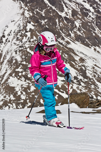 Girl on skis in the mountains