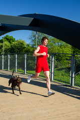 Sportsman and dog running outdoors