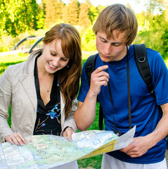 Couple traveling, they look at a map