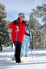 Old couple skiing together