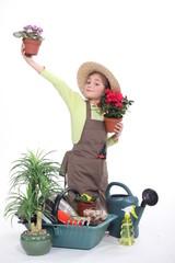 little girl gardening isolated on white