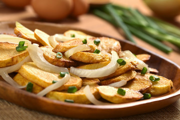 Homemade crispy fried potato slices with fried onion