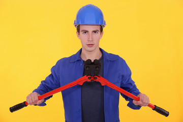 Young worker with bolt cutters