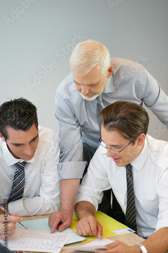 A team of business professionals looking at the budget