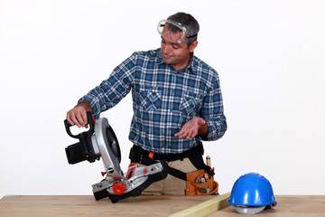 Man using industrial saw
