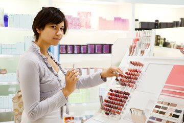 girl  buying lipstick at  shop