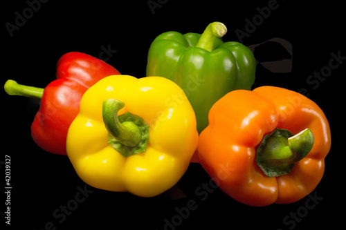Color peppers on a black background.