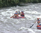 rubber boats ride down wildwater river. Extreme tourist trip