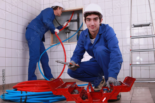 Plumbing team with a toolbox