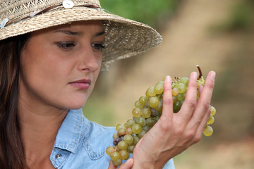 Woman looking at grapes