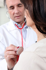 Woman in check-up with doctor