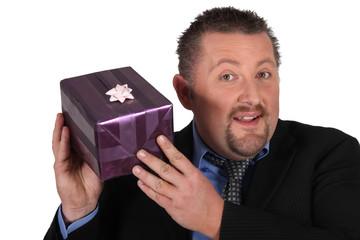Man shaking a gift