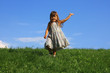 Little girl running on a meadow