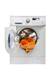 The washing machine filled with dirty linen.