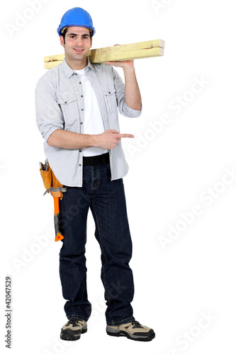 Carpenter standing on white background