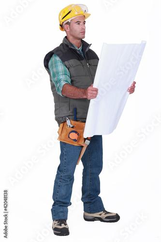Foreman contemplating plans