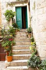 View on open green door - Trogir