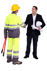 architect shaking hands with craftsman