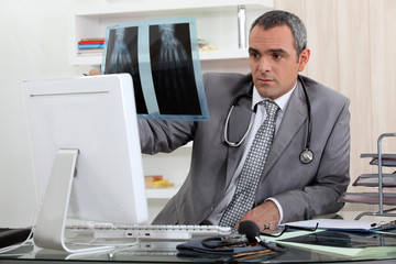 Doctor looking at X